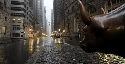 The Wall Street bronze Bull looks out to an empty Broadway in Lower Manhattan, New York, early August 28, 2011 as Hurricane Irene hits the city and Tri State area with rain and high winds. New York City resembled a ghost town after 370,000 people were told to evacuate flood-prone areas, including near Wall Street and at Coney Island, and mass transport was shut down. AFP PHOTO/Stan HONDA (Photo credit should read STAN HONDA/AFP/Getty Images)